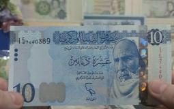 الدينار الليبي.