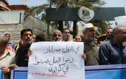 جانب من وقفة العمال المتعطلين عن العمل قبال مجلس الوزراء في غزة