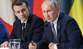 الرئيس الروسي فلاديمير بوتين ونظيره الفرنسي إيمانويل ماكرون